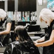 Stylist cutting hair in the Village Pointe Salon