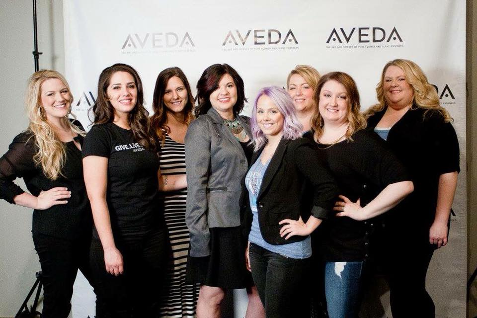 Garbos Group Photo in front of Aveda Banner