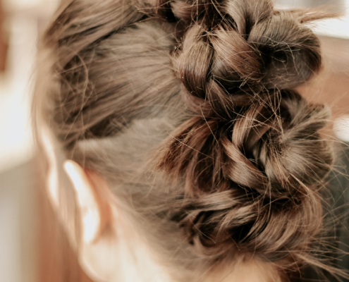 Barre Code and Garbo's Collab - Fitness Hairstyles - Four Braided Buns Close Up